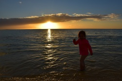 Our 3 and a half year old watching the sunset while playing in the gentle waves in Mauritius!